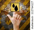 Hand press touch oil symbol on industry background - stock photo