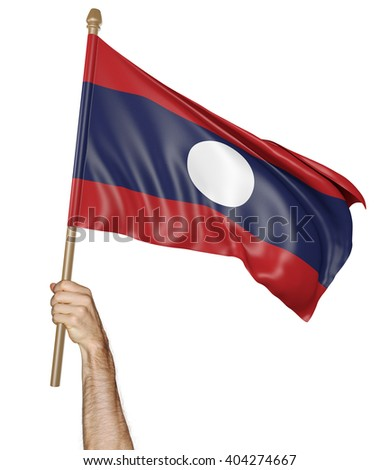 Hand proudly waving the national flag of Laos