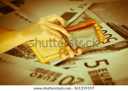 hand put coin from purse with blur banknote background