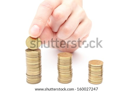 Hand put coins to stack of coins. Isolated on white background