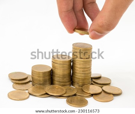 Hand put coins to stack of coins on white background .