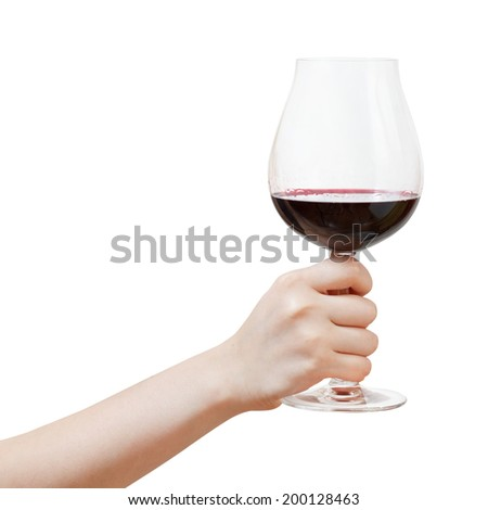 hand rises big glass with red wine isolated on white background