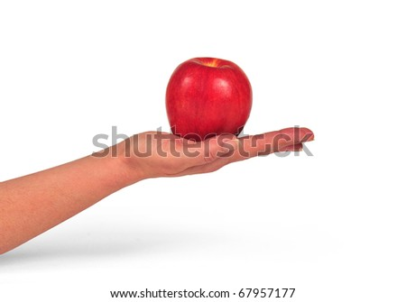 hand sustaining an apple