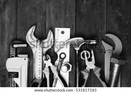 Hand tools on a workbench. black and white