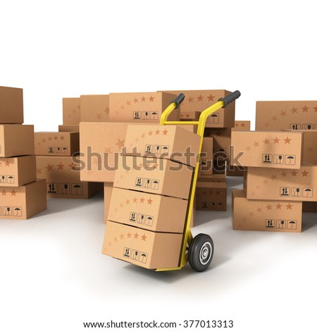 Hand truck with boxes standing on the background of boxes of different sizes