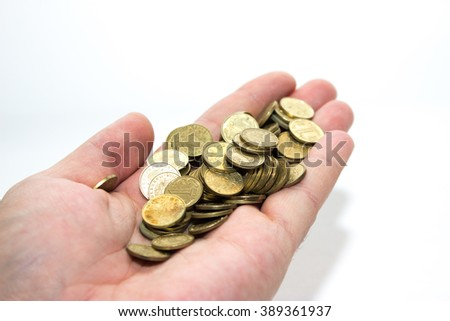 Hand with a bunch of coins currency Kazakhstan Tenge