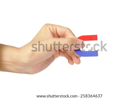 Hand with a magnet