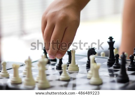 Hand with chess pieces closeup