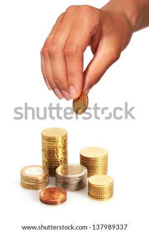 Hand with coin isolated over white background.