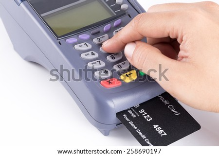 Hand With Credit card machine isolated on white background