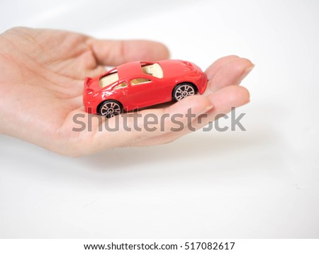 hand with the car or vehicle toy