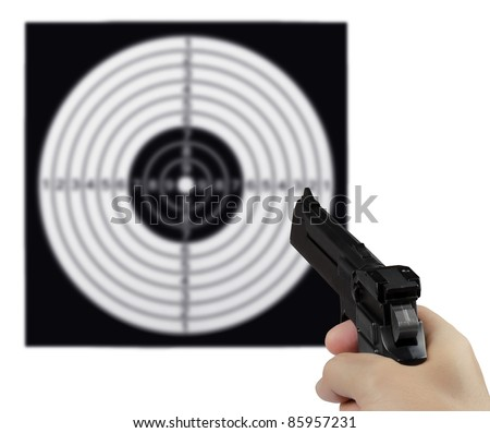 Hand with the gun against the shooting target