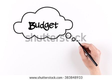 Hand writing Budget on white paper, View from above