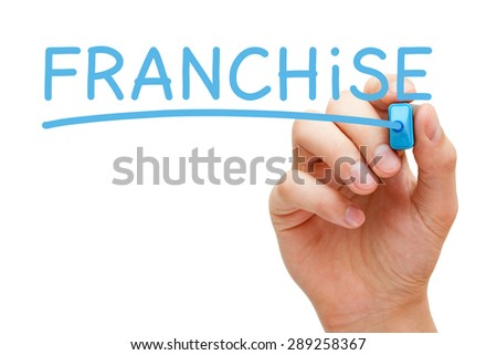 Hand writing Franchise with blue marker on transparent wipe board.