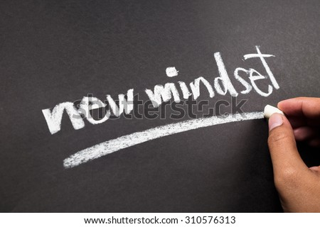 Hand writing New Mindset topic with chalk