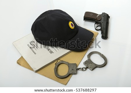 "Handcuffs and police operational documents. The inscription on the documents ""Delo""."