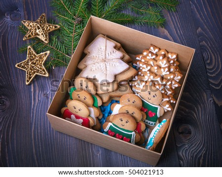 Handmade patterned gingerbreads  in the box over old wooden table