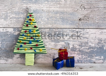 Handmade product colorful christmas tree and three bowsof wood  background. Copyspace.