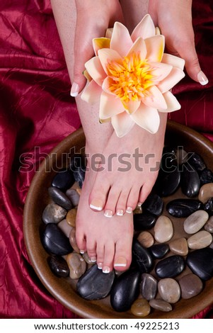 Hands and feet of a female being pampered