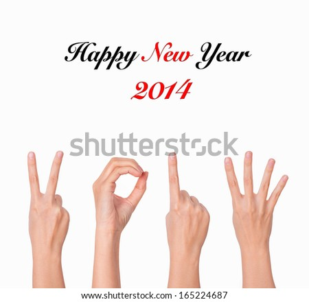 hands forming number 2014. new year background