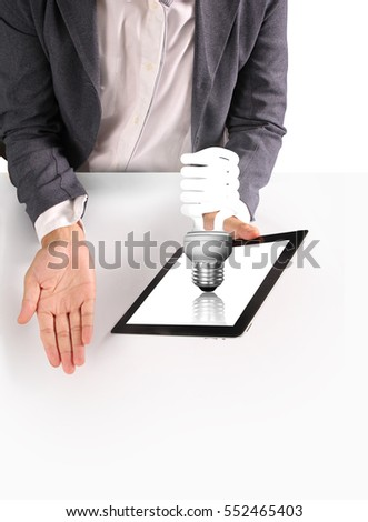 hands holding and pointing on contemporary digital tablet