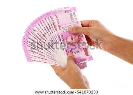Hands holding Indian 2000 rupee notes against white background