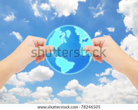 Hands holding the earth against blue sky