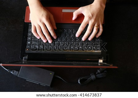 Hands multitasking man working on laptop connecting wifi internet, businessman hand busy using laptop at office desk, finger typing on keyboard computer sitting at wooden table,hardworking life