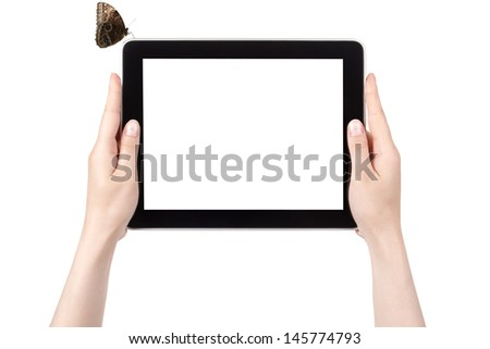 Hands of a woman holding digital tablet with butterfly  displaying a white screen.