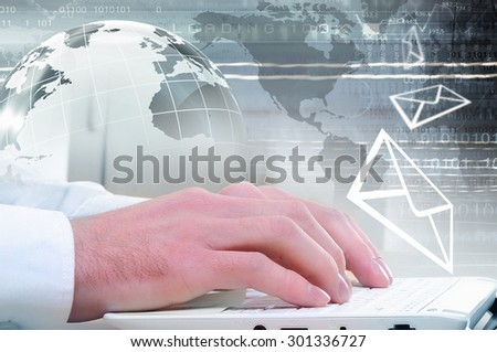 Hands of businessman running with fingers on laptop keyboard