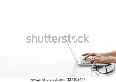 Hands of businesswoman typing on laptop