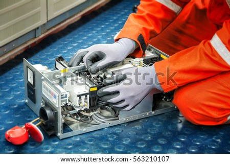 stock photo hands of electricianduring clean up switching electric actuator equipment in fuse box 563210107 circuit breakerfusebox four automatic fuses electricity stock fuse box cleaner at couponss.co