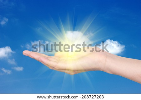 Hands with a bright sun