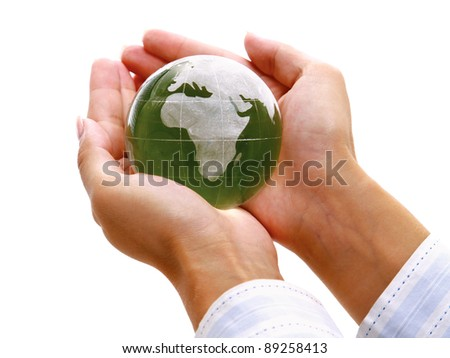 hands woman holding a glass globe