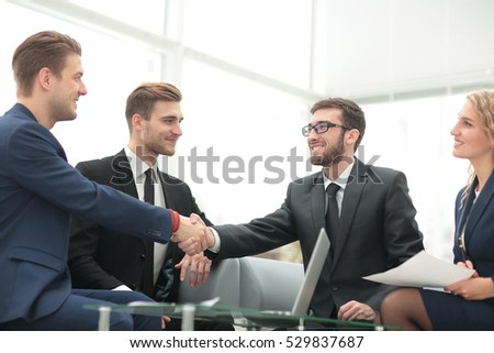 Handshake between businesspeople in a modern office
