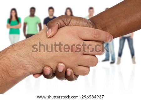 Handshake between races a over white background with unfocused people of background