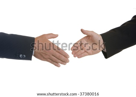 Handshake of businessmen after signing of contract