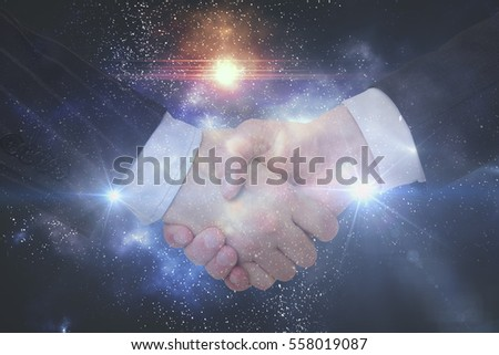 handshake on space background. Double exposure