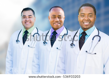 Handsome African American and Hispanic Male Doctors Outside of Hospital Building.