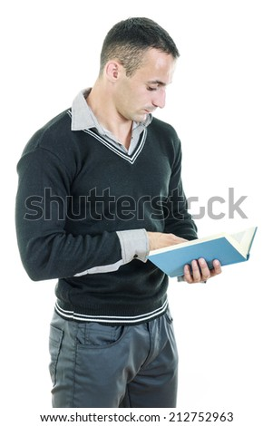 Handsome athletic man reading book dressed elegant and seriously studying