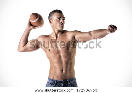 Handsome, athletic young man shirtless, throwing american football ball, isolated on white