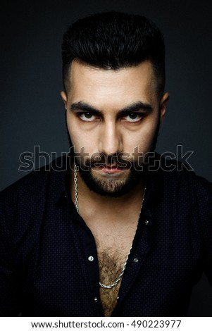 Handsome bearded man wearing shirt, portrait shot in studio