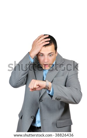Handsome businessman checking his wrist-watch isolated on white background