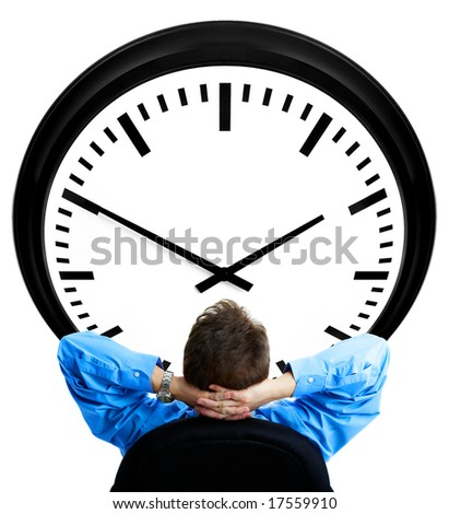 Handsome businessman looking at the clock. Over white