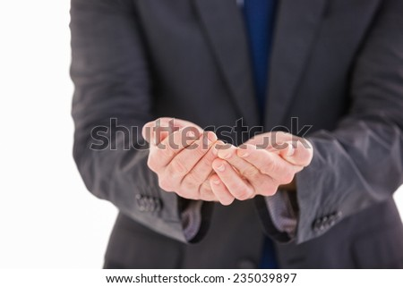 Handsome businessman presenting with hands on white background