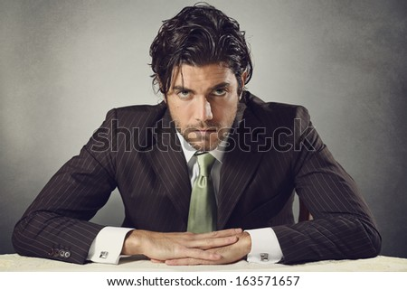 Handsome businessman with resolute expression and deep gaze