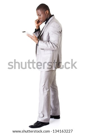 Handsome businessman with tablet , isolated on white