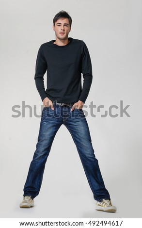 Handsome casual man smiling - isolated over a gray background