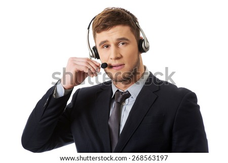 Handsome happy smiling customer support phone operator.