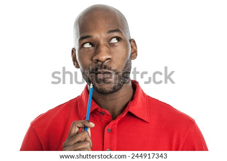 Handsome late 20s black man with pencil on chin thinking isolated on a white background